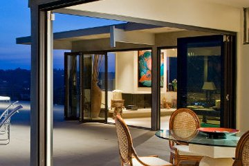 Modern aluminum patio folding doors overlooking the city skyline. Bringing the Outside In. Open and Airy