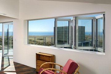 Large opening window Aluminum folding on beach front property with a large open floor plan bedroom.