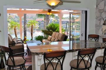 Sliding door for large opening onto a California Patio entertainment space. Hidden doors Disappearing doors.