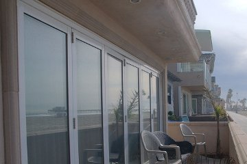 Beach front Property Movable glass walls that makes an open and airy atmosphere.