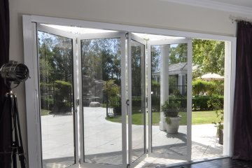 White Marble fireplace with low e coated glass doors leading to outdoor garden. LowE doors.