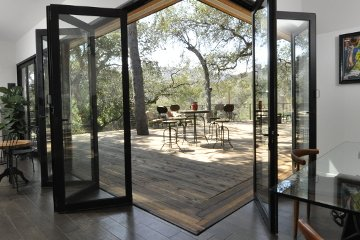 impressive opening offering a unique design to replace walls with movable sliding glass folding doors.