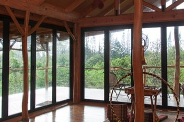 Open floor lodge zen design bring the outdoors in with seamless transition to wood deck.