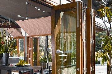 Modern concept design with wood folding accordian glass wall. Metal fan. Bifold Doors. & Lanai Doors Bifolding Glass Walls and Folding Doors Systems - Gallery