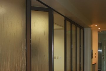 Office to hall way glass sliding door divider. Privacy glass wall. ADA Compliant.