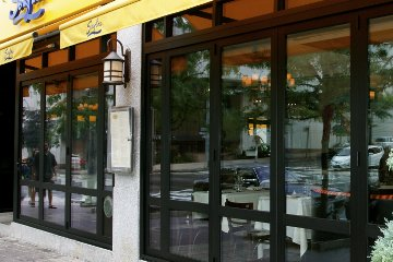 Sidewalk store front that allows natural light. Open and airy atmosphere. ADA Compliant. Egress Door.