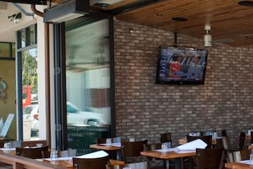 Flexible Restaurant patio with operable bi-folding sliding door. Egress Door. ADA Compliant.