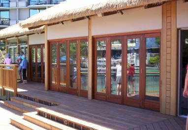 Lanai Doors Wood Folding Glass Patio Doors Bringing the Outdoors In at this dolphin experience in Hawaii